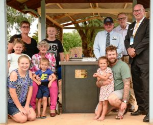Mary Brown (daughter of Faye and Noel) and her four grandchildren, Shayla, Ryan Alexis and Billy with Ruby Stevenson who was Faye's sister in law, (right) kneeling is Dan Wallace with daughter Lilly, standing is John Medcalf, the ambassador and Brian Nelson. Image Credit: Barry Green
