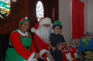 Seth McRae with Santa Claus. Image Credit: Kathy Parnaby.