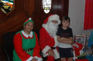 Krista Kirby, Santa Claus ans Dominic Herbert enjoyed the WCC Charity event last year. Image Credit: Kathy Parnaby.