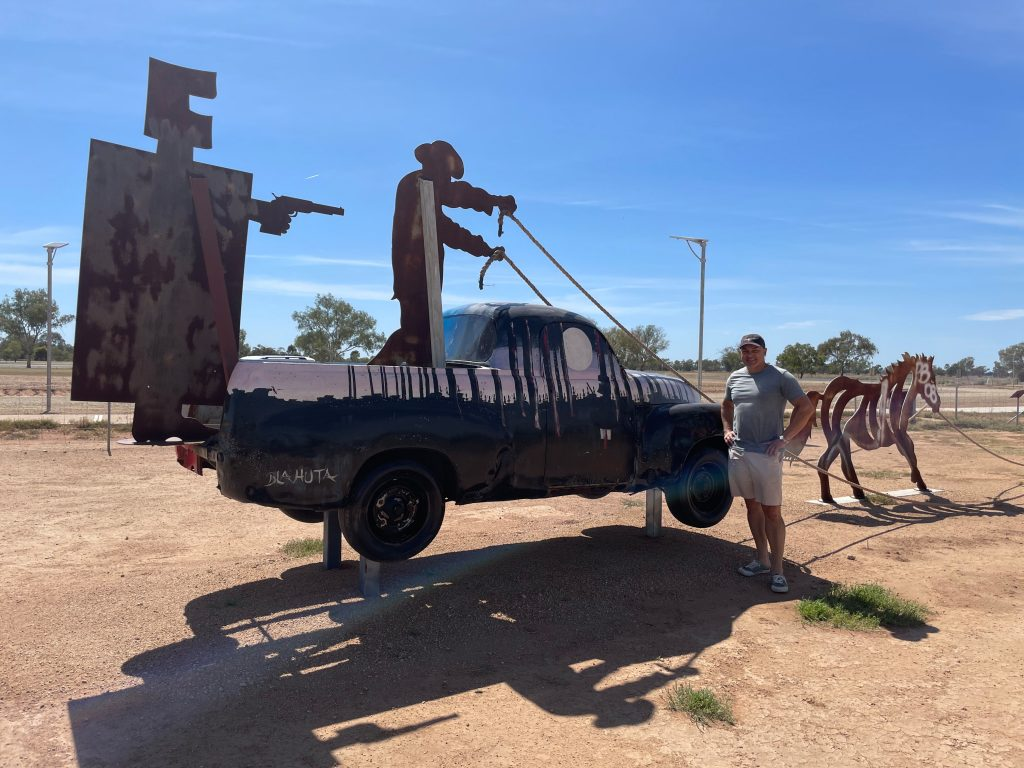 Artist Paul Blahuta showcases the reverse side of his Utes in the Paddock creation. He was impressed with all those involved from moving the project from Ootha to Condobolin. Image Contributed.