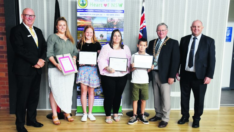 Lachlan Shire Australia Day Ambassador Allan Sparkes, CV, OAM, VA, FRSN, Lachlan Shire Young Citizen of the Year recipient Emily Sinderberry of Condobolin, with other Young Citizens nominees, Holly Leighton (Condobolin), Katy Quinn (Lake Cargelligo), Tate Dwyer (Lake Cargelligo), Lachlan Shire Mayor John Medcalf OAM and Lachlan Shire Council General Manager Greg Tory. Image Credit: Melissa Blewitt.