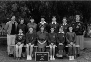 The Years Seven and Eight Classes of 1989 at Tullibigeal Central School included (back row) Jamie Warren, Melissa Fyfe, Daryl Newham, Barry Dillion, and Troy Glasgow; together with (front row) Leslie Wright, Terrie Leadbitter, Mrs Julie Nourse (Principal), Tanya Ireland, Adrienne Haworth and Shannon Noll. Teachers were Geoff Metcalf (far left) and Mary Lewis (far right).  Image Credit: West Wyalong and Beyond Facebook Page.