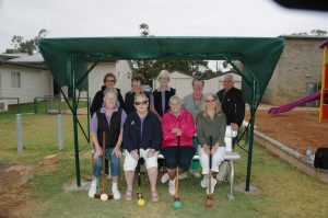 Betsy Wheeler, Dawn Jones, Nancy Dodgson, Kay Harley, Shirley Bell, Genene Reardon, Liz Crook and Allan Dodgson showing off the new seats for the Croquet Club. Image Credit: Kathy Parnaby.