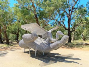 The 6.5 metre, 3.5 tonne hyper-realistic hand cradling a great white egret, titled 'Bird in Hand' was made from 1,600 meters of 10 millimetre, 316 marine grade, stainless steel chain, with 38 links per meter and four welds per link. It was created by Gold Coast sculptor Michael 'Mike' Van Dam. Image Credit: Forbes Art Society.