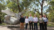 Forbes Shire Council's Steve Karaitiana, Jenny Webb and Graeme Miller with sculptor Mike van Dam, Arts Society's Keith Mullette and Lachlan Shire Council's Debra Kean and Paula Ewing. Image Credit: Forbes Art Society.