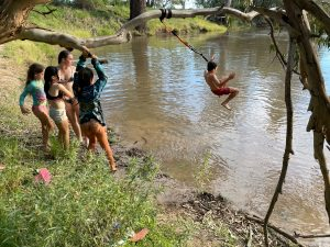Children took advantage of the beautiful weather over the Easter break, and enjoyed a dip and a swing into the Lachlan River. Image Credit: Melissa Blewitt.