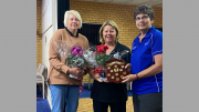 Chris and Beth receiving flowers from Narelle Hayward. Image Contributed.