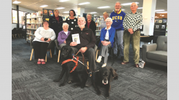Ross Fitzell with Harry (right) and Pluto and the delighted audience at West Wyalong Library. Source and Image Credit: Tom Gosling