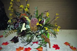 The flower arrangement guest presenter, Helen Webber created during the evening. Image Credit: I Love West Wyalong Facebook Page.
