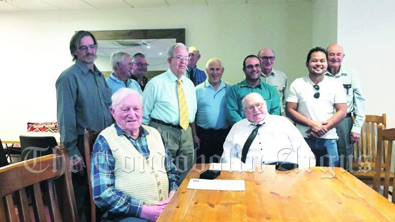 Members of Lodge gather to congratulate R. W.Bro Mick Press and W Bro Hugh Crerar. Image Credit: Anne Coffey.