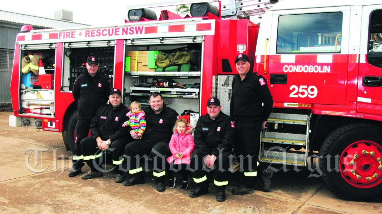 Mark Phillips, Nathan Dodgson, Edie Fyfe, Michael Fyfe, Hattie Fyfe, Daniel Lark and Guy Marchant at the Fire and Rescue attended the NSW (FRNSW) Open Day in Condobolin on Saturday, 15 May. Image Credit: Kathy Parnaby.