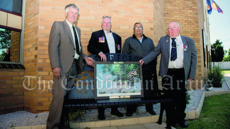Private Garry Lewis, Cpl Graeme Yetman, President of the Condobolin RSL Club Michael Wighton and Private James Stewart with the special 'Lament for the dead of Long Tan' photograph that was presented to the members of the Condobolin RSL Sub Branch on ANZAC Day (25 April). Image Credit: Kathy Parnaby.
