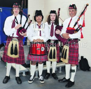 Rob Neal (far right) with Condobolin HIgh School members of the RSL Pipe Band - Connor Thompson, Daniel Gile and Jesse Pawsey. Image Credit: Melissa Blewitt.
