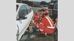 SES volunteers training with the Jaws of Life to lift a car off a patient. They have 30 minutes to get them out and into an ambulance. Image Credit: Kathy Parnaby.