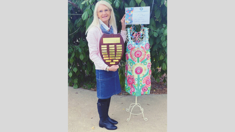 """Condobolin's Terryll Cassidy has won the NSW County Women's Association Recycled Article Competition with her unique """"Colourful Spring Bouquet Dress and Necklace"""" creation. Image Contributed."""