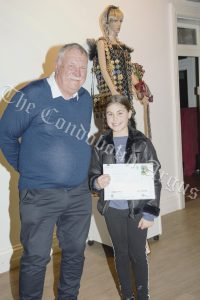 Lachlan Shire Councillor Dennis Brady with Anastasia Phillips, who won the Primary 3D section with her entry 'Ted Kelly'.