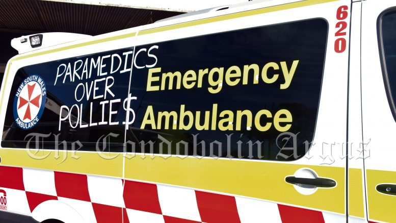 """The Australian Paramedics Association NSW members including those in Condobolin are taking action against what they see as an unfair wage increase. They have voted to chalk their ambulances as part of the industrial action campaign. Slogans seen on Condobolin ambulances include """"Overworked and Underpaid"""", """"Lives over KPI's"""" and """"Paramedics over Pollie$."""" Image Credit: Melissa Blewitt."""