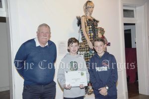 Lachlan Shire Councillor Dennis Brady with Silas Gallaher and Samuel Kissane (winners of the High School 3D category). Their entry was called 'Coke Can'.