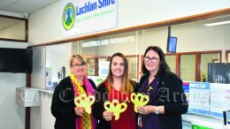 Lachlan Shire Council staff Eiline Smith, Immogine Turner and Aleah Geeves showcase ribbons and stickers, that highlight the importance of National Road Safety Week. Some 1,200 lives are lost and more than 44,000 are seriously injured on Australian roads each year. Image Credit: Melissa Blewitt.