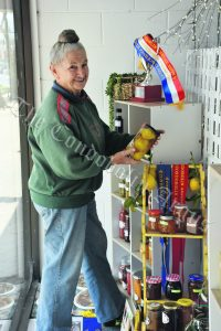 Ruth Worthington decorated the Condobolin Newsgency window with Class N: Jams, Pickles and Preserves section goodies. In 2019, there were 298 entries in the section, which were prepared by 65 competitors, 15 of whom were men. Image Credit: Melissa Blewitt.