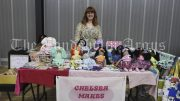 Chelsea Vane-Tempest with some of her handmade dolls. Image Credit: Lucy Kirk.