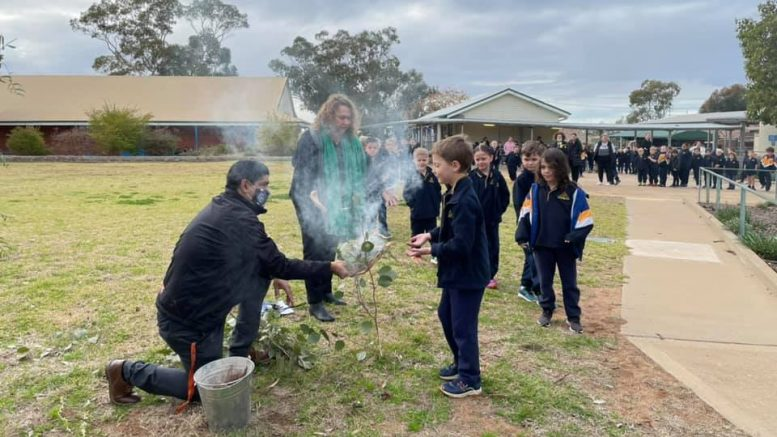 Condobolin Public School opened NAIDOC Week celebrations on Monday, 19 July with an assembly. All students Kindergarten to Year Six then participated in a cleansing welcome Smoking Ceremony. Image Credits: Condobolin Public School Facebook Page.