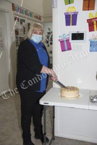 Rachel Brook cuts her farewell cake.