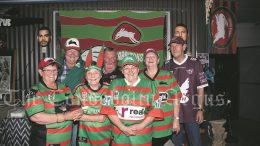 Rabbitohs supporters Fay Krebs, Len Krebs, Anne O'Hara, Kenny King, Jean Ticehurst, Sue O'Hara and Allan O'Hara may have been dispapointed with the 2021 Rugby League Grand Final result but remain loyal to the thier Club of choice. Image Credit: Kathy Parnaby.